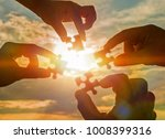 silhouette four hands trying to ... | Shutterstock . vector #1008399316