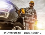 Caucasian Contractor in His 30s and His Modern Heavy Duty Pickup Truck For Heavy Loads. - stock photo