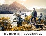 woman hiker stands on the coast ... | Shutterstock . vector #1008500722