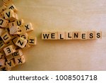 wellness word cube on wood... | Shutterstock . vector #1008501718