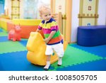 child playing with hopping... | Shutterstock . vector #1008505705