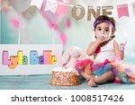 baby girl cake smash | Shutterstock . vector #1008517426