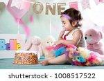 baby girl cake smash | Shutterstock . vector #1008517522