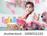 baby girl cake smash | Shutterstock . vector #1008531232