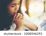 Small photo of woman hands praying to god with the bible. Woman Pray for god blessing to wishing have a better life. begging for forgiveness and believe in goodness. Christian life crisis prayer to god.