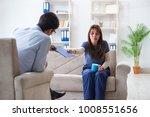 Small photo of Psychologist counselling woman beaten by husband