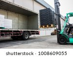 The Worker Loading Pallet With...