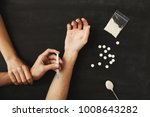 drug addict hands holding... | Shutterstock . vector #1008643282
