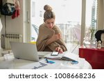 young beautiful woman works on... | Shutterstock . vector #1008668236