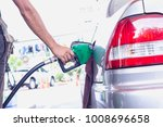 grey car at gas station being... | Shutterstock . vector #1008696658