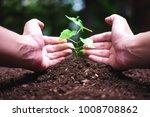 men hands planting the young... | Shutterstock . vector #1008708862