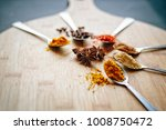 colorful spices on a wooden... | Shutterstock . vector #1008750472