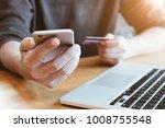 online payment man's hands... | Shutterstock . vector #1008755548