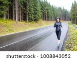 young sporty woman jogging on... | Shutterstock . vector #1008843052