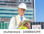 senior engineer man in suit and ... | Shutterstock . vector #1008864295