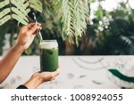 healthy green juice | Shutterstock . vector #1008924055