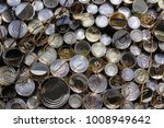 Small photo of Pile of different tins packed together inharmonious background