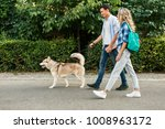 young stylish couple walking... | Shutterstock . vector #1008963172