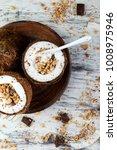 healthy breakfast in coconut... | Shutterstock . vector #1008975946