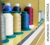 multicolored coils of thread... | Shutterstock . vector #1009002316