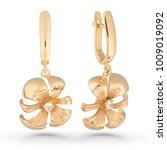gold earrings on white... | Shutterstock . vector #1009019092