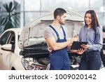 a man mechanic and woman... | Shutterstock . vector #1009020142