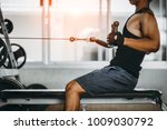 young man making low cable... | Shutterstock . vector #1009030792