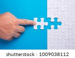hand holding piece of white... | Shutterstock . vector #1009038112