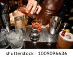 barman in a brown apron is... | Shutterstock . vector #1009096636