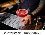 barman with a tattoo on his arm ... | Shutterstock . vector #1009098376