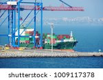 port cargo crane  ship and... | Shutterstock . vector #1009117378