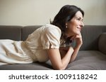woman lying on couch | Shutterstock . vector #1009118242