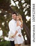 hugging bridal couple   Shutterstock . vector #1009125868