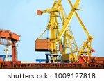 bulk cargo ship under port... | Shutterstock . vector #1009127818