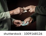 hand of addict man with money... | Shutterstock . vector #1009168126