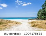 Small photo of Beautiful paradise like and empty places beaches with crystal clear water and pure white sand, Robinson Crusoe like at Coromandel peninsula, New Zealand, North Island