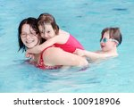happy family swimming in a pool. | Shutterstock . vector #100918906