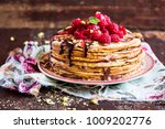 stack of homemade thin pancakes ... | Shutterstock . vector #1009202776