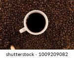 cup of coffee and coffee beans... | Shutterstock . vector #1009209082