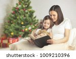 family mother and baby reading | Shutterstock . vector #1009210396