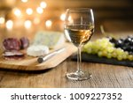 glass of white wine with french ... | Shutterstock . vector #1009227352