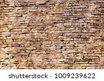 the brown wall made of old... | Shutterstock . vector #1009239622