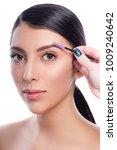 Small photo of Eyebrow correction. Eyebrow correction procedure for the smiling model with long eyelashes