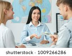 young couple in a tour agency... | Shutterstock . vector #1009266286