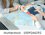 young couple in a tour agency... | Shutterstock . vector #1009266292