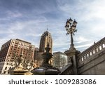 Small photo of Downtown Lansing Michigan Skyline. Skyscrapers in downtown Lansing Michigan as seen from the state capitol steps with ornate historical street lamp on the state capitol grounds in the foreground.