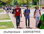 Small photo of State College, Pennsylvania, August 10, 2016 - New foreign students enrolled at Penn State University participate in an International Student Orientation during a tour of its main campus.