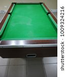 Small photo of an empty and big pool table
