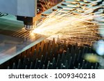 the fiber laser cutting machine ... | Shutterstock . vector #1009340218