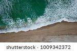 overhead shot of waves at... | Shutterstock . vector #1009342372